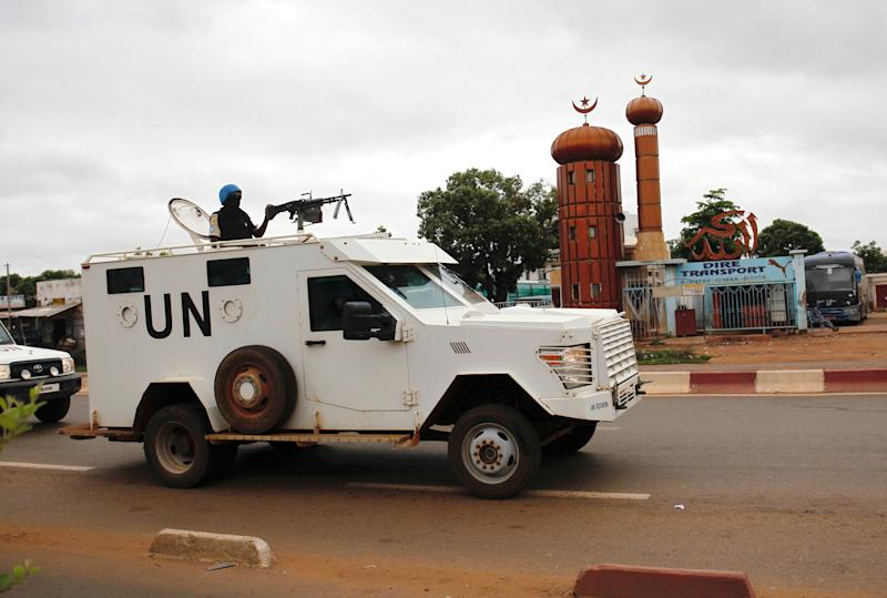 FILE PHOTO: U.N. vehicles patrol the street, prior to the presidential election, in Bamako