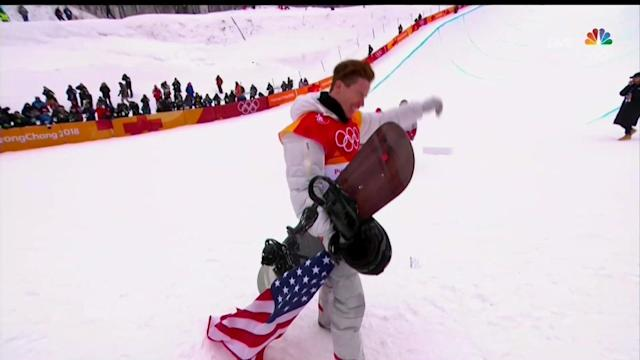 Shaun White drags the flag on the ground after his gold medal win in PyeongChang. (NBC screen shot)