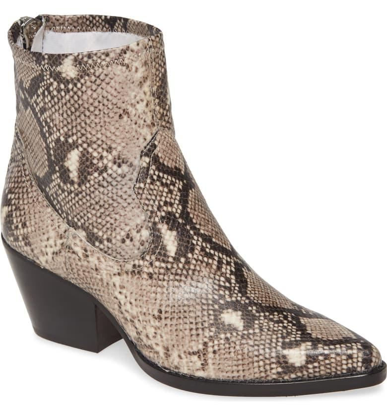"""<h3><a href=""""https://shop.nordstrom.com/s/dolce-vita-shanta-bootie-women/5514061/full"""" rel=""""nofollow noopener"""" target=""""_blank"""" data-ylk=""""slk:Dolce Vita Shanta Bootie"""" class=""""link rapid-noclick-resp"""">Dolce Vita Shanta Bootie</a></h3><br>Three major shoe-shopping trends of this past year collide into one: on-sale snakeskin booties. Rev your carts, this top-carted, western-chic pair from Dolce Vita is currently 40% off. <br><br><strong>Dolce Vita</strong> Shanta Bootie, $, available at <a href=""""https://shop.nordstrom.com/s/dolce-vita-shanta-bootie-women/5514061/full"""" rel=""""nofollow noopener"""" target=""""_blank"""" data-ylk=""""slk:Nordstrom"""" class=""""link rapid-noclick-resp"""">Nordstrom</a>"""