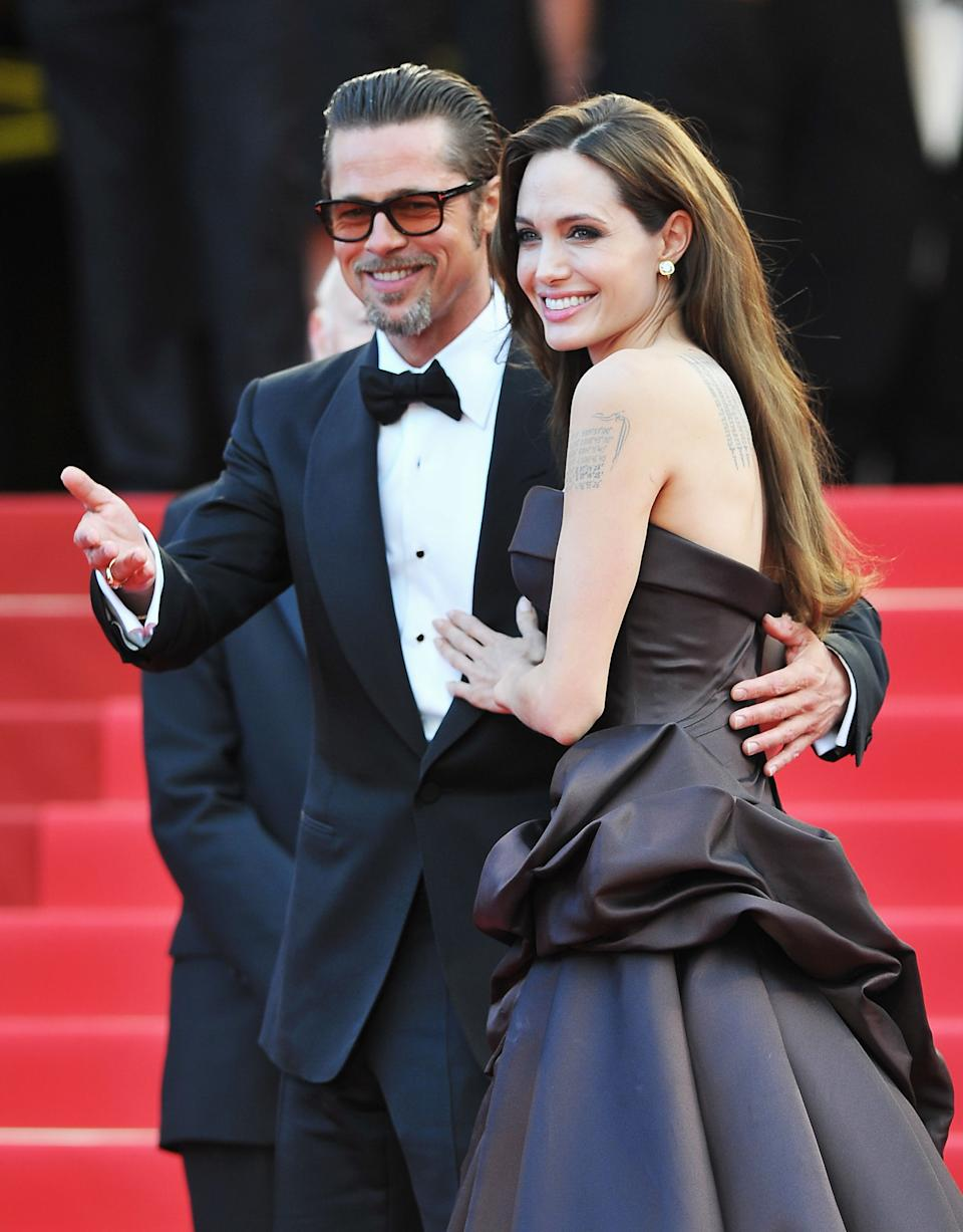 """<p>Pitt and Jolie's relationship remains a spectacle- even after their divorce. The """"Mr. & Mrs. Smith"""" co-stars made up two thirds of the most publicized love triangle in Hollywood history. The pair began publicly dating in 2005 but divorced in 2016 after two years of marriage. <em>(Image via Getty Images)</em></p>"""