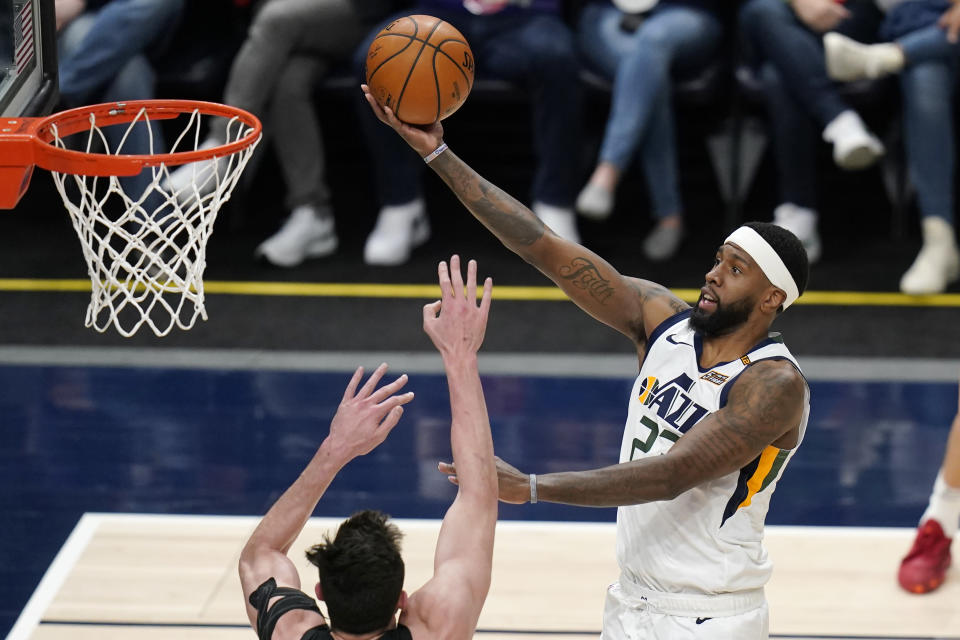 Utah Jazz forward Royce O'Neale (23) goes to the basket as San Antonio Spurs forward Drew Eubanks defends during the first half of an NBA basketball game Wednesday, May 5, 2021, in Salt Lake City. (AP Photo/Rick Bowmer)