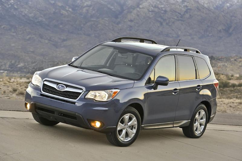 This photo provided by Subaru shows the 2014 Subaru Forester.  The Subaru Forester, well known as a durable and eminently functional compact sport utility vehicle, adds more power, more room, more safety features and a retuned suspension for 2014. The new, fourth-generation Forester also has higher fuel economy ratings than its predecessor, 24 miles per gallon in city driving and 32 mpg on the highway with base, 170-horsepower, four-cylinder engine and fuel-efficient continuously variable transmission (CVT).  (AP Photo/Subaru)