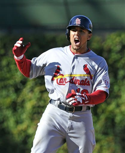St. Louis Cardinals' Jon Jay reacts after doubling in a run against the Chicago Cubs during the tenth inning of a baseball game Saturday, Sept. 22, 2012, in Chicago. (AP Photo/Jim Prisching)