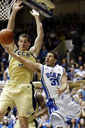 Duke's Seth Curry (30) drives around Georgia Tech's Daniel Miller during the first half of an NCAA college basketball game in Durham, N.C., Thursday, Jan. 17, 2013. (AP Photo/Gerry Broome)