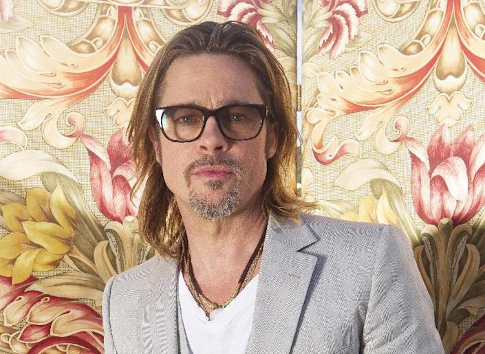 """FILE - This May 23, 2012 file photo shows actor Brad Pitt posing for portraits during the 65th Cannes Film Festival in Cannes, France. Pitt has agreed to donate $100,000 to help the Human Rights Campaign raise money for its efforts to support same-sex marriage initiatives in several states.The nation's largest gay rights group announced Wednesday, Oct. 31, that Pitt agreed to match contributions from the group's members up to $100,000. In an e-mail to members of the Human Rights Campaign, Pitt wrote that it's """"unbelievable"""" that people's relationships will be put to a vote on Election Day. (AP Photo/Joel Ryan, file)"""