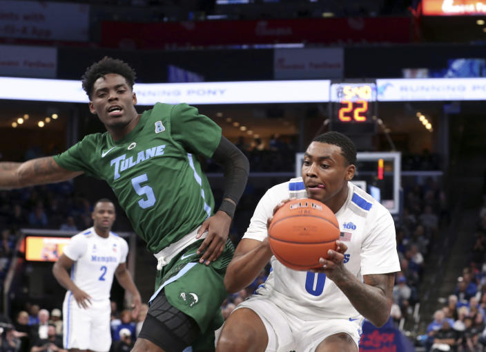 Memphis' forward D.J. Jeffries pushes past Tulane guard Teshaun Hightower (5) in the second half of an NCAA college basketball game Monday, Dec. 30, 2019, in Memphis, Tenn. (AP Photo/Karen Pulfer Focht)