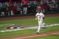 Los Angeles Angels' Albert Pujols (5) runs the bases after hitting a home run during the fourth inning of an MLB baseball game against the Chicago White Sox Friday, April 2, 2021, in Anaheim, Calif. Mike Trout and Justin Upton also scored. (AP Photo/Ashley Landis)