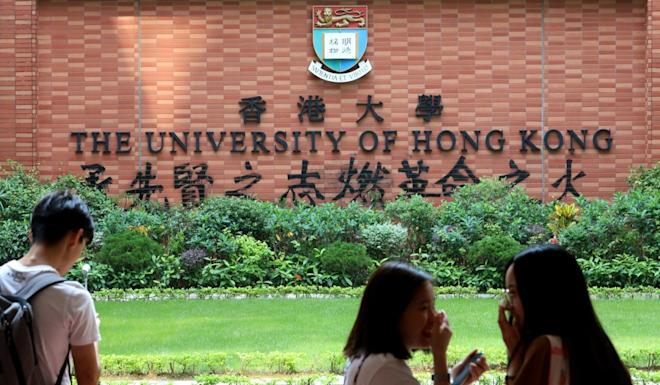 """A wall bearing the University of Hong Kong crest has the phrase, """"Inherit the past aspiration, to light the fire of the Revolution,"""