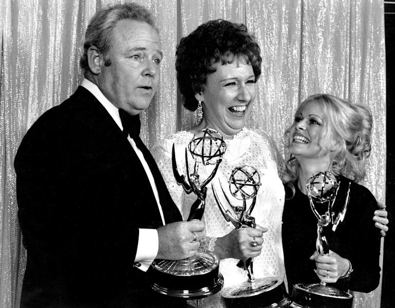 "FILE - Cast members of ""All in the Family,"" from left, Carroll O'Connor, Jean Stapleton, and Sally Struthers pose with their Emmys backstage at the 24th annual Emmy Awards in Hollywood, Ca., Sunday night, May 14, 1972. O'Connor and Stapleton won outstanding continued performance by an actor and actress in a leading role in a comedy series. Struthers tied in the category of outstanding performance by an actress in a supporting role in a comedy. Stapleton has died at the age of 90. John Putch said Saturday, June 1, 2013 that his mother died Friday, May 31, 2013 of natural causes at her New York City home surrounded by friends and family. (AP Photo)"