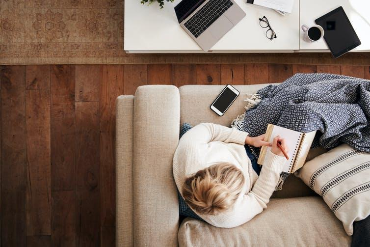 """<span class=""""caption"""">Working from home.</span> <span class=""""attribution""""><a class=""""link rapid-noclick-resp"""" href=""""https://www.shutterstock.com/image-photo/overhead-shot-looking-down-on-woman-1442875778"""" rel=""""nofollow noopener"""" target=""""_blank"""" data-ylk=""""slk:Shutterstock/MonkeyBusinessImages"""">Shutterstock/MonkeyBusinessImages</a></span>"""