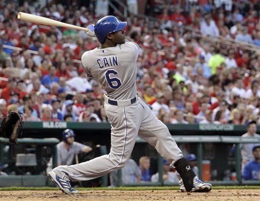 Kansas City Royals' Lorenzo Cain watches his sacrifice fly that scored Alex Gordon during the fourth inning of a baseball game against the St. Louis Cardinals on Wednesday, May 29, 2013, in St. Louis. (AP Photo/Jeff Roberson)