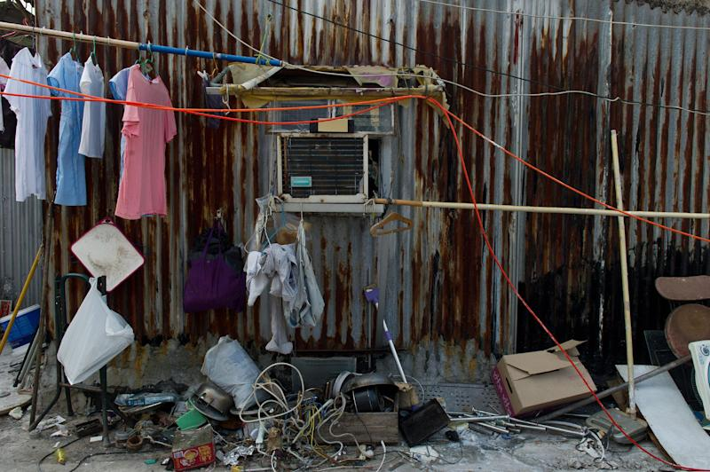 Laundry drying outside the corrugated metal wall of a resident's rooftop house in the Sham Shui Po district of Hong Kong on October 10, 2013