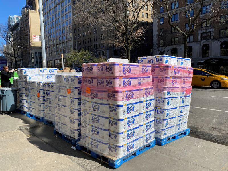 Pallets of toilet paper fill the sidewalk in front of grocer Fairway in Manhattan on Sunday after panicky shoppers depleted shelves, amid fears of the global growth of coronavirus cases, in Manhattan, New York