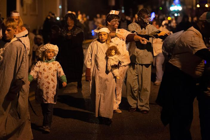 People of all ages participate in a walk of the undead at the Milton Zombie Fest 2018 in downtown Milton, Del.
