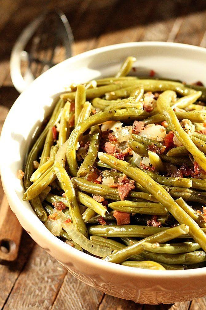 """<p>This recipe couldn't be any easier to make. Simply toss all ingredients in and let the slow cooker work its magic.</p><p><strong>Get the recipe at <a href=""""https://southernbite.com/southern-slow-cooker-green-beans/"""" rel=""""nofollow noopener"""" target=""""_blank"""" data-ylk=""""slk:Southern Bite"""" class=""""link rapid-noclick-resp"""">Southern Bite</a>.</strong> </p>"""