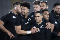 New Zealand's Ardie Savea, left, congratulates teammate New Zealand's Aaron Smith afterSmith's his 100th test after their Bledisloe Cup rugby union test match against Australia at Eden Park in Auckland, New Zealand, Saturday, Aug. 7, 2021. (Brett Phibbs/Photosport via AP)