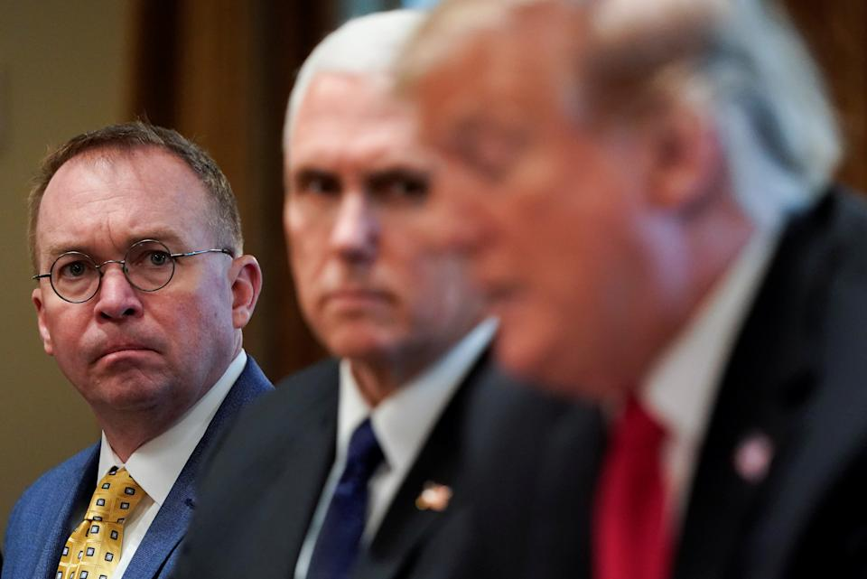 White House Acting Chief of Staff Mick Mulvaney and Vice President Mike Pence listen as President Donald Trump speaks during a meeting in the Oval Office, April 2, 2019. (Joshua Roberts/Reuters)