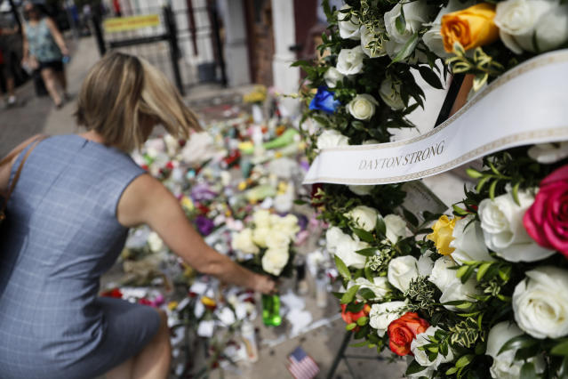 Mourners bring flowers to a makeshift memorial Tuesday, Aug. 6, 2019, for the slain and injured in the Oregon District after a mass shooting that occurred early Sunday morning, in Dayton. (AP)