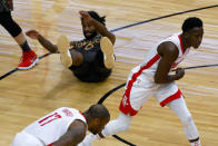 Chicago Bulls guard Coby White (0) lays on the ground after fighting for the ball with the ball against Houston Rockets guard Victor Oladipo, right, and forward P.J. Tucker (17) during the first half of an NBA basketball game Monday, Jan. 18, 2021, in Chicago. (AP Photo/Matt Marton)