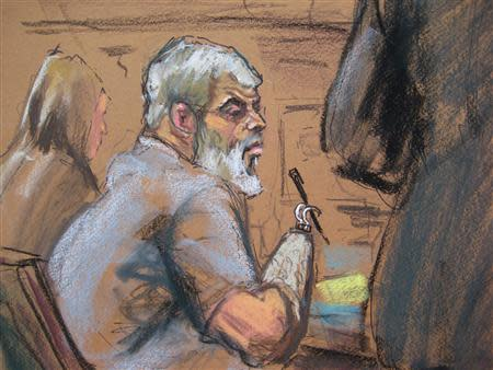 Abu Hamza al-Masri, the radical Islamist cleric facing U.S. terrorism charges, listens while former hostage Mary Quin testifies in Manhattan federal court in New York