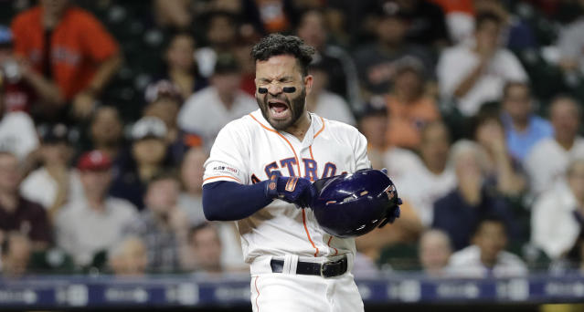 FILE - In this Sept. 17, 2019, file photo, Houston Astros' Jose Altuve reacts after being called out on strikes during the sixth inning of a baseball game against the Texas Rangers in Houston. The photo was part of a series of images by photographer David J. Phillip which won the Thomas V. diLustro best portfolio award for 2019 given out by the Associated Press Sports Editors during their annual winter meeting in St. Petersburg, Fla. (AP Photo/David J. Phillip, File)