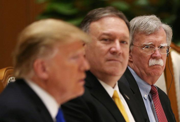 John Bolton (right) attends a working lunch alongside President Trump (left) and Secretary of State Mike Pompeo (center) in Hanoi, Vietnam, Feb. 27, 2019. (Leah Millis/Reuters)