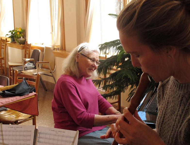Joanne Karp, left, a resident at the Fellowship Community adult home in Chestnut Ridge, N.Y., leads a music lesson with aide Chela Crane on Thursday, Jan. 31, 2013. Residents at the home are encouraged to contribute their talents to the community. (AP Photo/Jim Fitzgerald)