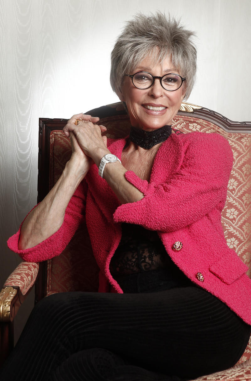 """FILE - In this March 6, 2012 file photo, actress Rita Moreno poses for a portrait at the Waldorf Astoria Hotel in New York. Moreno will receive SAG-AFTRA's Life Achievement Award for career achievement and humanitarian accomplishment at the 2014 Screen Actors Guild Awards. SAG-AFTRA Co-President Ken Howard said the 81-year-old actress is the 50th recipient of the award, """"the most prestigious honor we bestow."""" (AP Photo/Carlo Allegri, File)"""