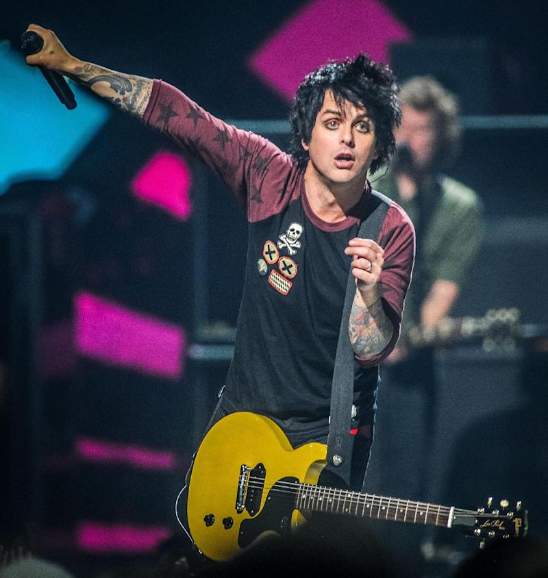 FILE - This Sept. 21, 2012 file photo shows Billie Joe Armstrong of Green Day on stage at the iHeart Radio Music Festival at the MGM Grand Arena in Las Vegas.  Green Day revs up for a world tour that was postponed by Armstrong entering rehab when the Grammy-winning punk band plays the South by Southwest music festival on Friday night, March 15, 2013. (Photo by Eric Reed/Invision/AP, file)