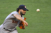 Houston Astros starting pitcher Lance McCullers Jr. throws to the plate during the first inning of a baseball game against the Los Angeles Angels Friday, July 31, 2020, in Anaheim, Calif. (AP Photo/Mark J. Terrill)