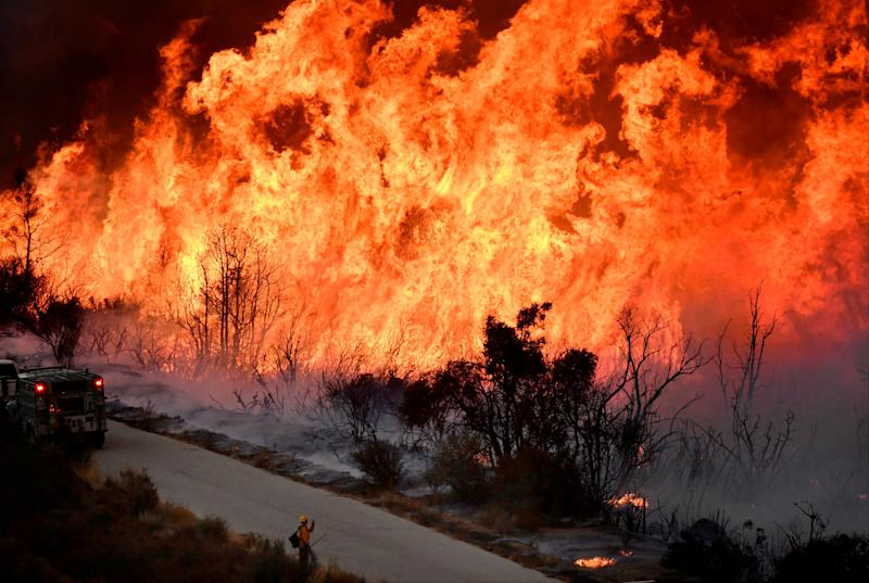 Firefighters battle the massive Thomas fire near Ojai, California, on Dec. 9. (Gene Blevins / Reuters)