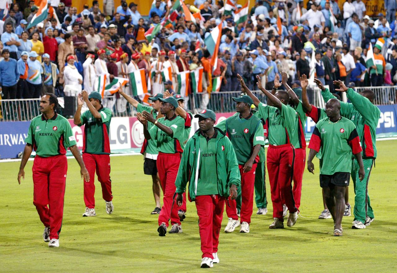 Kenyan captain Steve Tikolo (C) leads his team on a lap of honour after losing to India in their in their ICC World Cup semi-final match played at the Kingsmead Stadium in Durban 20 March 2003.  Batting first, India scored 270-4 with Sourav Ganguly not out on 111 and then dismissed Kenya for 179 to win by 91 runs.  India will now face Australia in the final to be played at the Wanderers Stadium in Johannesburg 23 March.   AFP PHOTO/William WEST