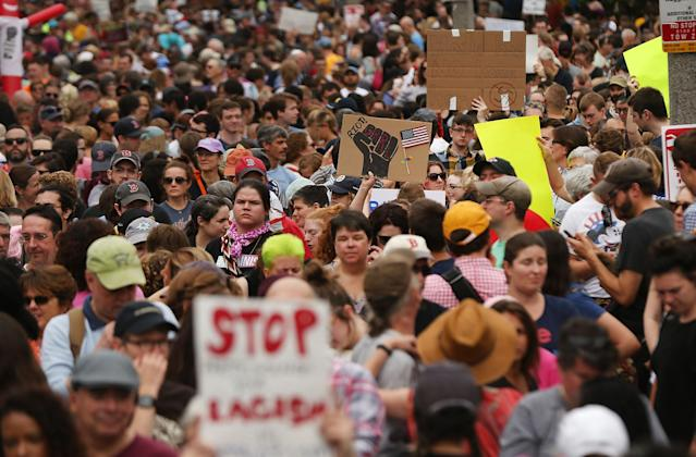 <p>Thousands of protesters prepare to march in Boston against a planned 'Free Speech Rally' just one week after the violent 'Unite the Right' rally in Virginia left one woman dead and dozens more injured on Aug. 19, 2017 in Boston, Mass. (Photo: Spencer Platt/Getty Images) </p>