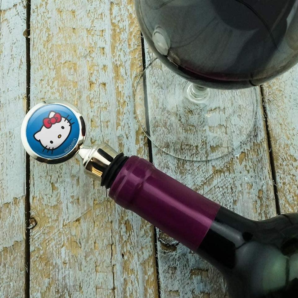 <p>Keep your wine preserved the right way with the <span>Hello Kitty Face Wine Bottle Stopper</span> ($11).</p>