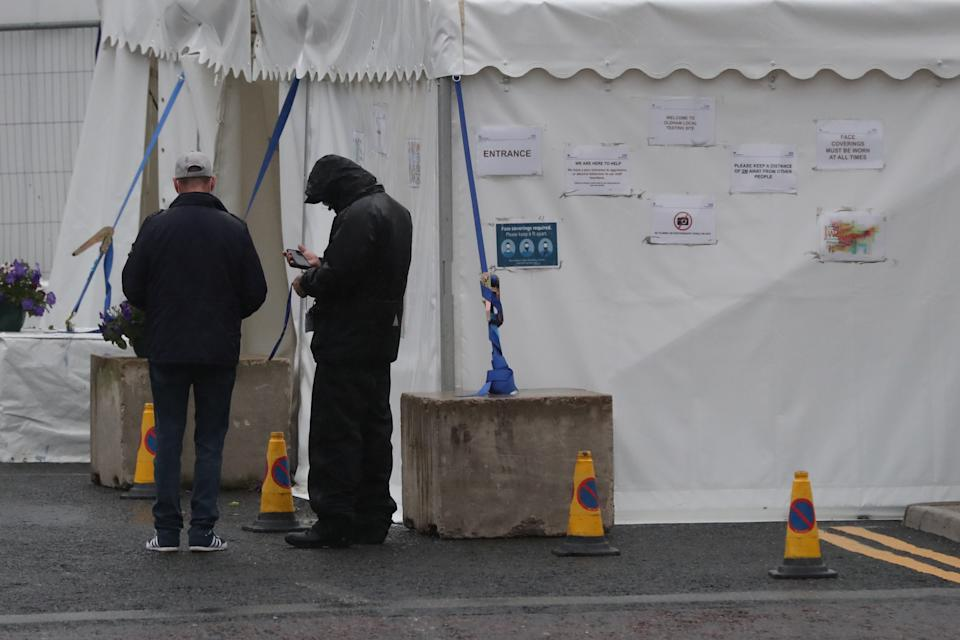 A walk-in coronavirus testing centre on Southgate Street, Oldham, Greater Manchester, as people living in Oldham, Blackburn, and Pendle in Lancashire have been told not to socialise with anyone outside their household and avoid using public transport unless it is essential. The localised measures have been introduced following a rise in people testing positive for coronavirus.