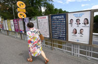 Municipal elections campaign posters of various different parties spread along a footpath in Turku, Finland, on June 8, 2021. Finland holds local elections upcoming Sunday June 13, 2021, in a first litmus test for the popular young Social Democratic prime minister, Sanna Marin, who took office a mere 18 months ago. (Vesa Moilanen/Lehtikuva via AP)