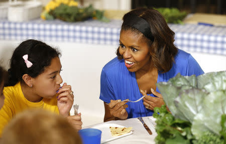 U.S. first lady Obama speaks with school children after making a salad together using the summer crop from the White House Kitchen Garden at the White House in Washington