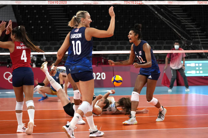 United States' Justine Wong-Orantes, left, United States' Jordan Larson and United States' Jordan Thompson celebrate winning a point during the women's volleyball preliminary round pool B match between United States and Argentina at the 2020 Summer Olympics, Sunday, July 25, 2021, in Tokyo, Japan. (AP Photo/Frank Augstein)