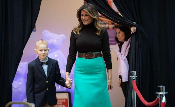 PHOTO: First lady Melania Trump arrives to read the book, 'Oliver the Ornament Meets Belle', with patient Declan McCahan, during a visit to Children's National Hospital in Washington, Dec. 6, 2019. (Saul Loeb/AFP via Getty Images)