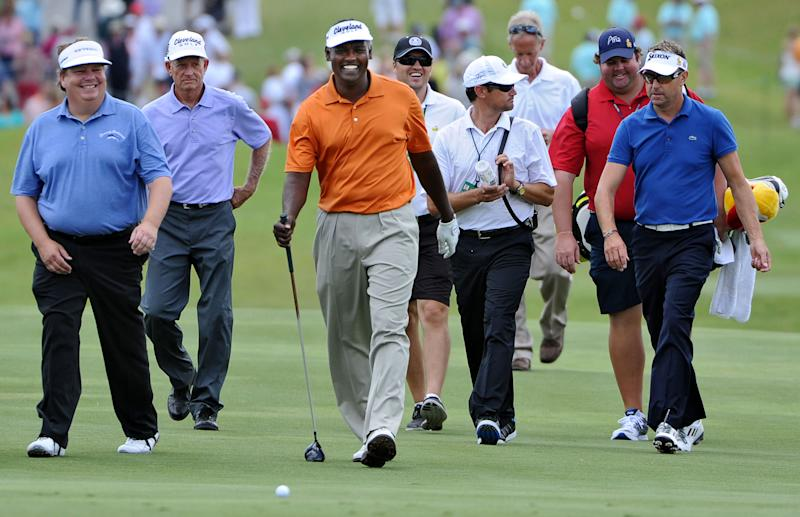 """Vijay Singh, center, walks up the 18th fairway with Charlie Beljan, far left, and Robert Allenby, far right, during a practice round at The Players Championship golf tournament Wednesday, May 8, 2013, in Ponte Vedra Beach, Fla. Singh sued the PGA Tour on Wednesday for exposing him to """"public humiliation and ridicule"""" during a 12-week investigation into his use of deer antler spray that ended last week when the tour dropped its case against him. (AP Photo/The Florida Times-Union, Bob Mack)"""