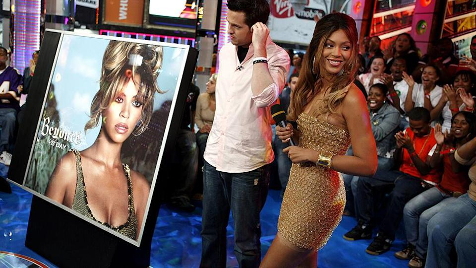 """Beyonce Knowles and VJ Damien Fahey appear onstage during MTV's """"Total Request Live"""" Tuesday, Sept. 5, 2006 in New York. (AP Photo/Jason DeCrow) - Credit: ASSOCIATED PRESS"""