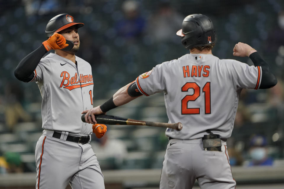 Baltimore Orioles' Rio Ruiz, left, is greeted by Austin Hays (21) after Ruiz hit a solo home run against the Seattle Mariners during the fifth inning of a baseball game, Tuesday, May 4, 2021, in Seattle. (AP Photo/Ted S. Warren)