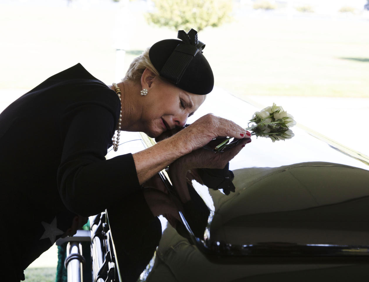 <p>In this photo provided by the family of John McCain, Cindy McCain lays her head on the casket of Sen. John McCain, R-Ariz., during a burial service at the cemetery at the United States Naval Academy in Annapolis, Md., on Sunday, Sept. 2, 2018. (Photo: David Hume Kennerly/McCain Family via AP) </p>