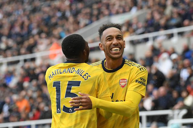 NEWCASTLE UPON TYNE, ENGLAND - AUGUST 11: Pierre-Emerick Aubameyang of Arsenal celebrates with teammate Ainsley Maitland-Niles after scoring his team's first goal during the Premier League match between Newcastle United and Arsenal FC at St. James Park on August 11, 2019 in Newcastle upon Tyne, United Kingdom. (Photo by Stu Forster/Getty Images)