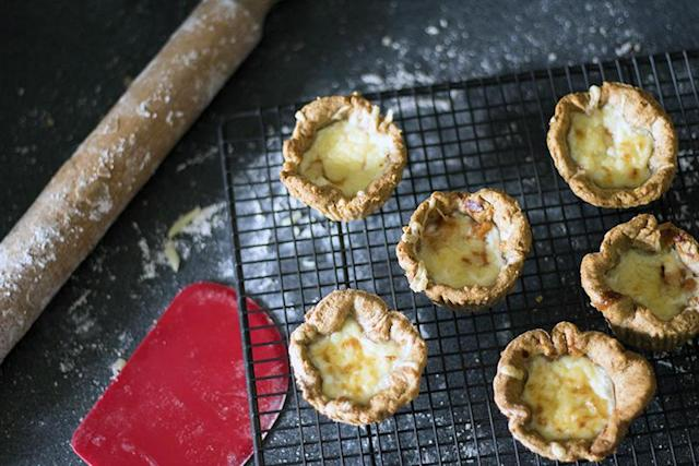"""<p>For parents on the go, these mini cheese and bean pies are the perfect last minute addition to school packed lunches. For the full recipe, visit <a href=""""https://www.sneakyveg.com/baked-bean-and-cheese-mini-pies-with-flora/"""" rel=""""nofollow noopener"""" target=""""_blank"""" data-ylk=""""slk:Sneaky Veg"""" class=""""link rapid-noclick-resp"""">Sneaky Veg</a>. </p>"""