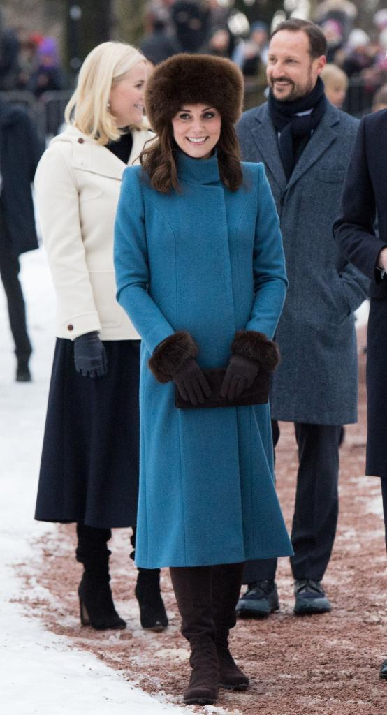 <p>For the second stint of the royal tour, the Duchess of Cambridge donned a blue Catherine Walker coat accessorised with faux fur cuffs and a co-ordinating hat. <em>[Photo: Getty]</em> </p>