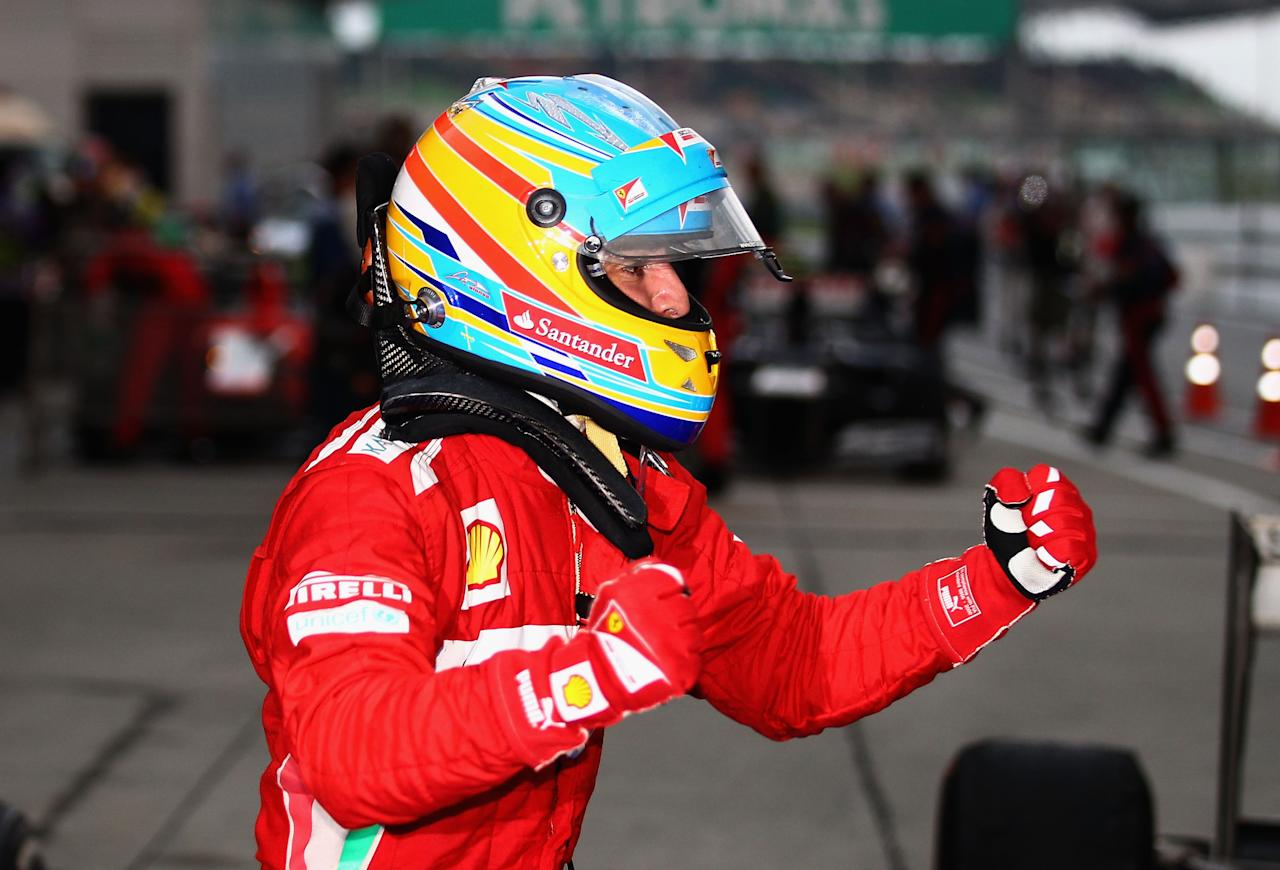 KUALA LUMPUR, MALAYSIA - MARCH 25:  Fernando Alonso of Spain and Ferrari celebrates in parc ferme after winning the Malaysian Formula One Grand Prix at the Sepang Circuit on March 25, 2012 in Kuala Lumpur, Malaysia.  (Photo by Clive Mason/Getty Images)