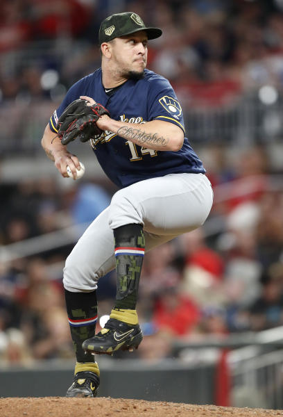 Milwaukee Brewers third baseman Hernan Perez pitches in relief during the eighth inning of the team's baseball game against the Atlanta Braves on Friday, May 17, 2019, in Atlanta. The Braves won 12-8. (AP Photo/John Bazemore)