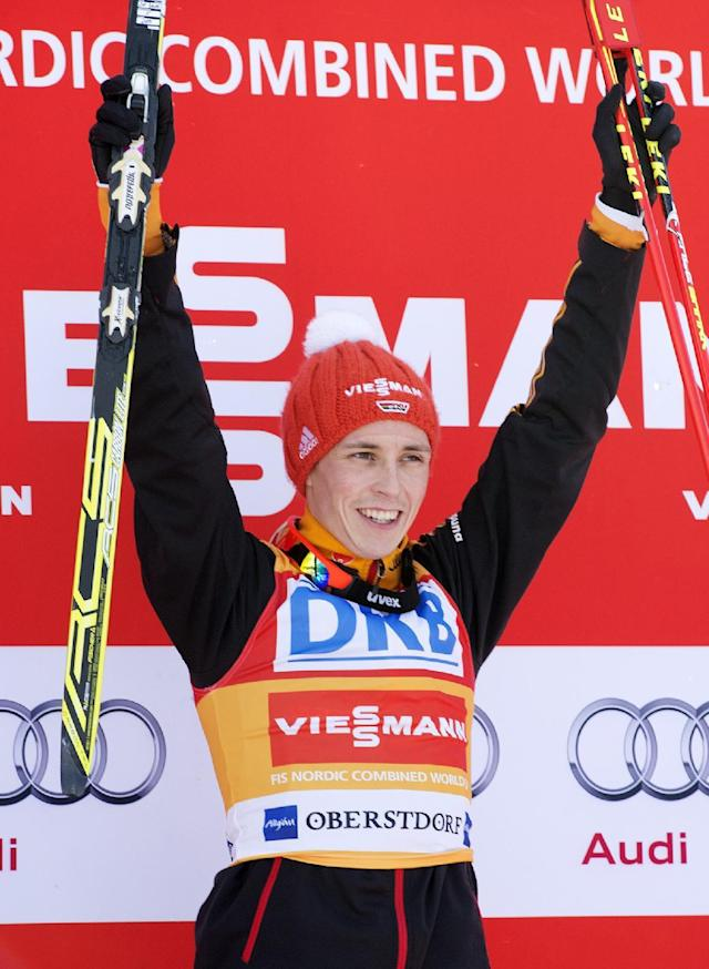 Winner Eric Frenzel of Germany celebrates on the podium during the individual Gundersen competition at the Nordic Combined FIS World Cup in Oberstdorf, southern Germany, Sunday, Jan. 26, 2014. (AP Photo/Jens Meyer)