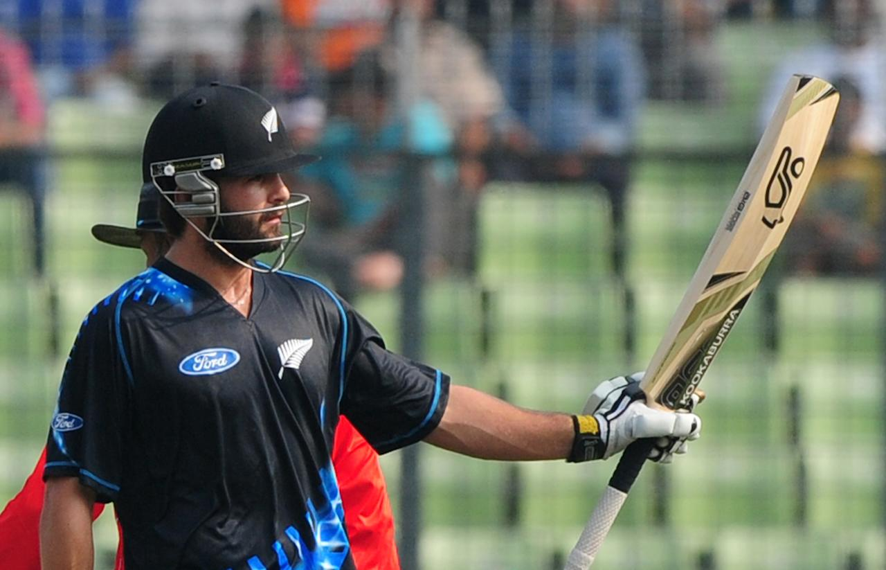 New Zealand batsman Anton Devcich reacts after scoring a half century (50 runs) during the T20 match between Bangladesh and Zew Zealand at the Sher-e-Bangla National Cricket Stadium in Dhaka on November 6, 2013. AFP PHOTO/ Munir uz ZAMAN        (Photo credit should read MUNIR UZ ZAMAN/AFP/Getty Images)